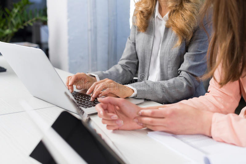 Businesswomen Use Laptop Computer Typing On Keyboard, Teamwork Concept, Open Space Office Two Business Women Working On stock image