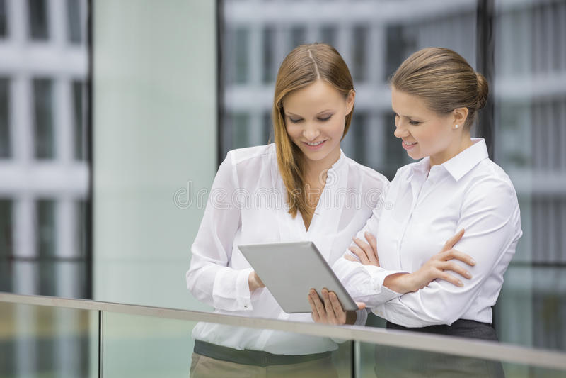 Businesswomen using digital tablet in office stock photo