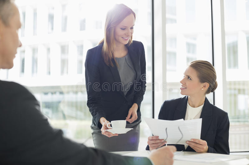 Businesswomen working at cafeteria royalty free stock image
