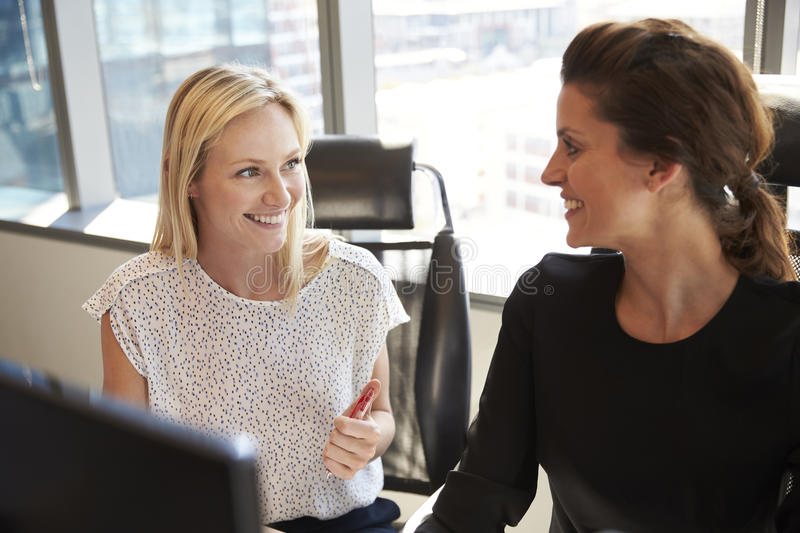 Businesswomen Working At Office Desk On Computer Together royalty free stock image