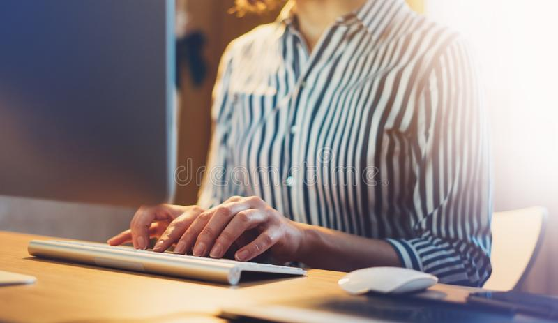 Businesswomen working at office with monitor computer at night, young hipster manager typing on keyboard, female hands texting mes stock photos