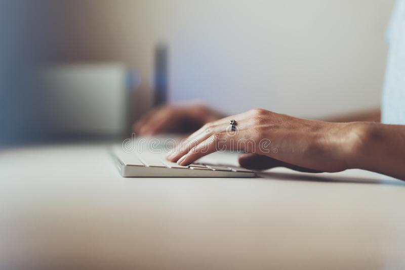 Businesswomen working at office with monitor computer, young hipster manager typing on keyboard, closeup finger female hands text stock photography