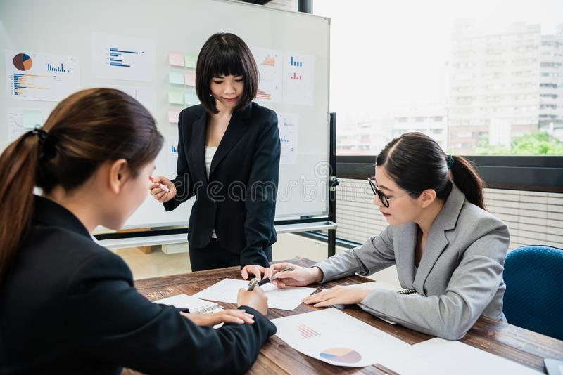 Businesswomen working together and discussing project. royalty free stock photos
