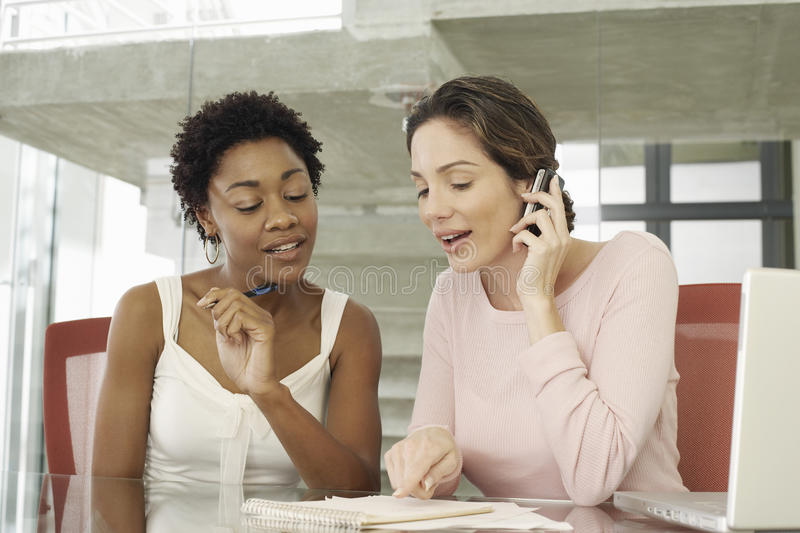 Businesswomen Working Together At Table royalty free stock photo