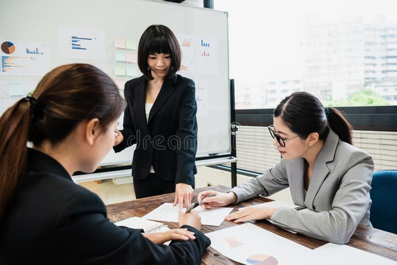 Businesswonman introducing project to colleagues stock photo