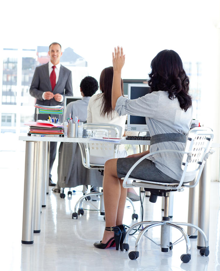 Busineswoman asking a question. To a manager in a meeeting office royalty free stock photos