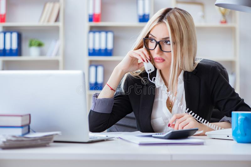The busineswoman frustrated working in the office. Busineswoman frustrated working in the office stock photo