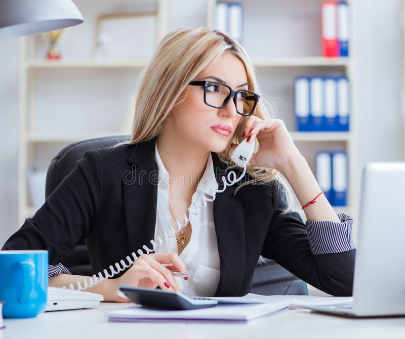 Busineswoman frustrated working in the office. The busineswoman frustrated working in the office stock photo