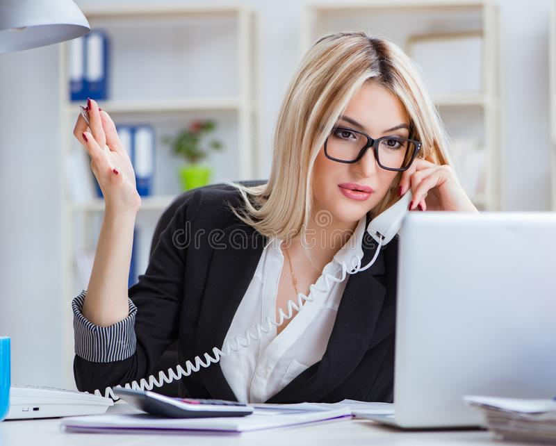Busineswoman frustrated working in the office. The busineswoman frustrated working in the office royalty free stock photography