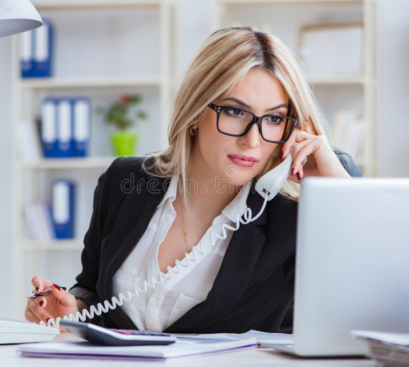 Busineswoman frustrated working in the office. The busineswoman frustrated working in the office stock image