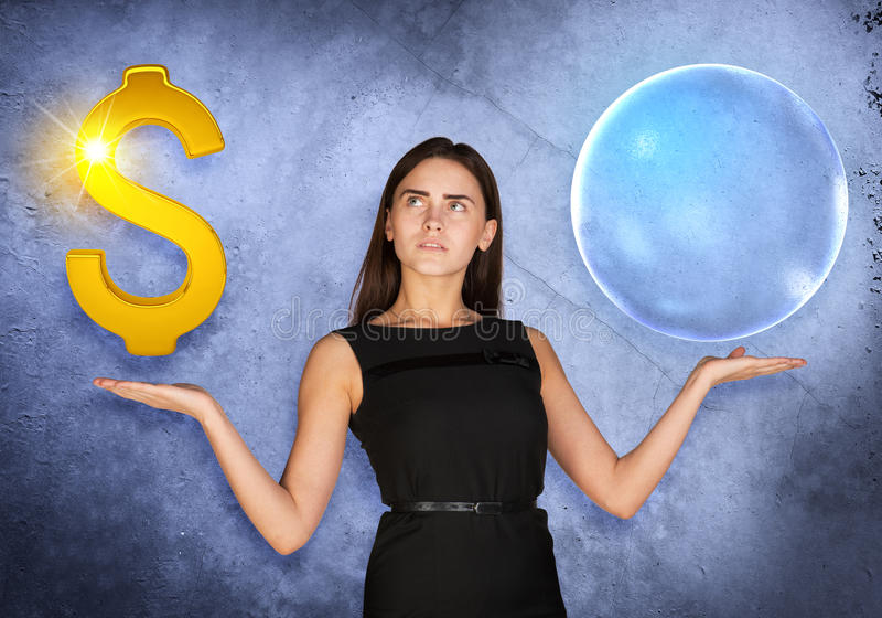 Busineswoman holding dollar sign and big bubble. On grey background stock photography