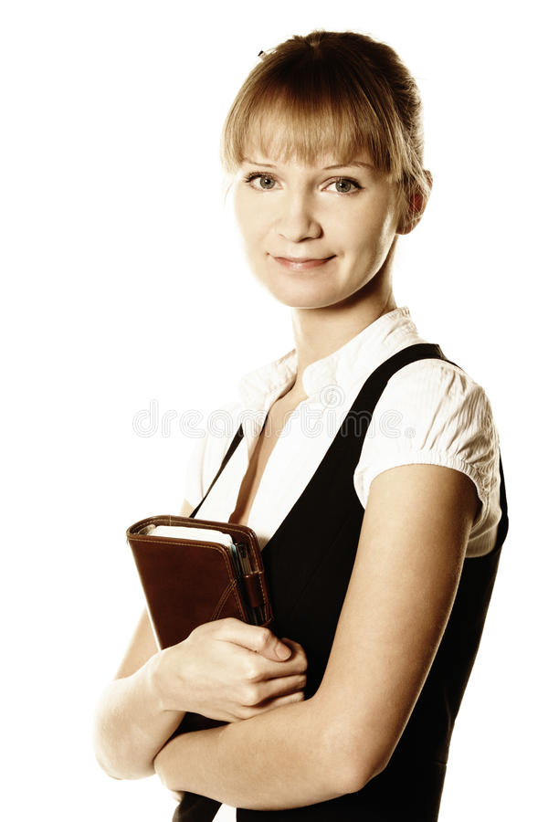 Busineswoman holding notepad. Blonde busineswoman holding notepad photo over white royalty free stock image