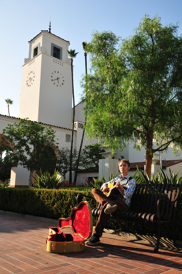 Download Busker and clock tower stock photo. Image of busker, guitarist - 6749974