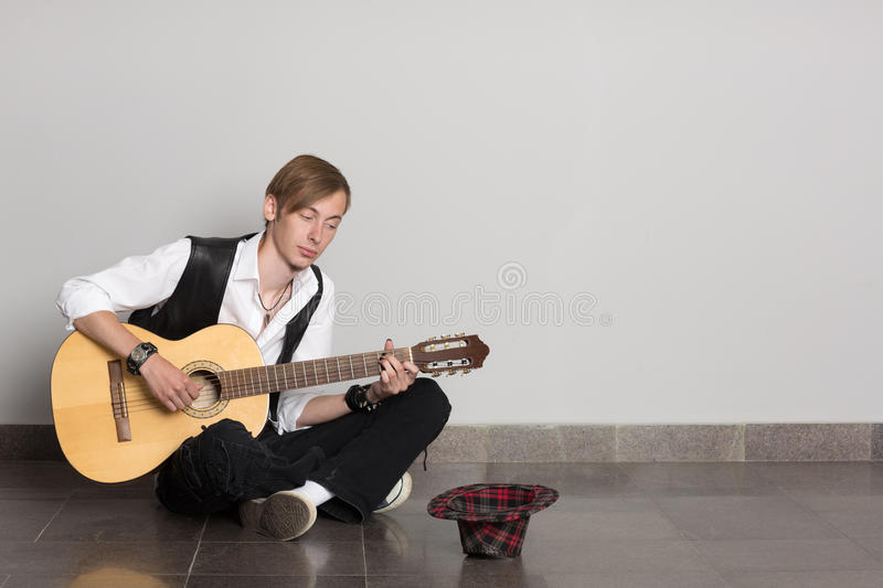 Busker playing his guitar stock photography