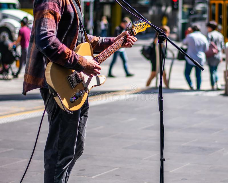 Busker on sidewalk royalty free stock photos