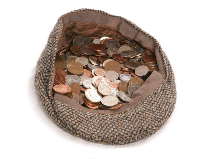 Busking flache Schutzkappe mit britischen Münzen lizenzfreies stockbild