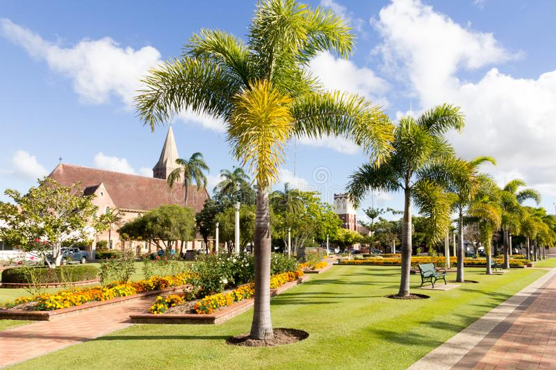 Buss park with Christ Church and the former Presyterian St Andrews church now Seventh Day Adventist church in the background,. Bundaberg, Australia - 19th May royalty free stock photo