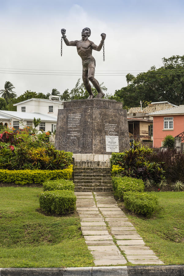 Bussa Emancipation Statue in Barbados. Statue of a slave rebellion leader named Bussa, on the Caribbean island of Barbados in the West indies. The statue is royalty free stock images