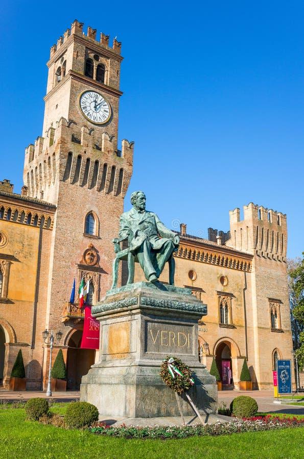 Busseto, the birthplace of Giuseppe Verdi. Busseto, Italy - November 29, 2013: The Giuseppe Verdi monument in front of the Pallavicino Rocca stock photo
