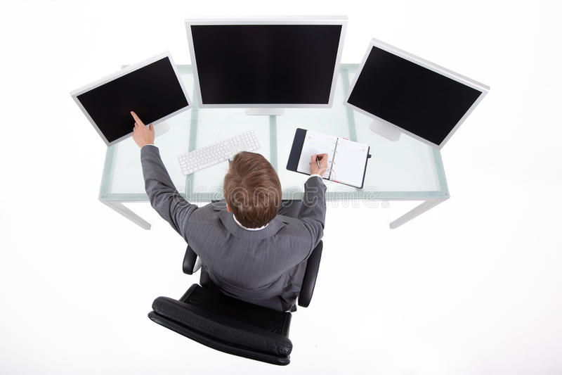 Bussines man in his office upper view. Businessman in his clean high tech office looking on the monitors upper view royalty free stock photography