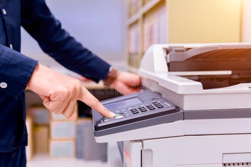 Bussiness man Hand press button on panel of printer. stock images