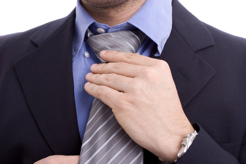 Bussinessman fixing his tie. Businessman fixing his tie, isolated on white royalty free stock photography