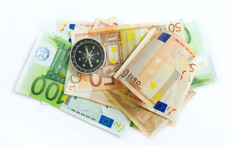 Bussola sui soldi. fotografia stock libera da diritti