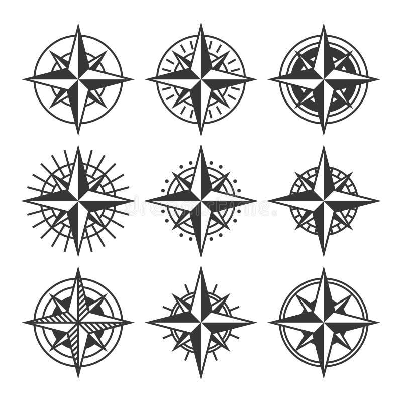 Bussole con l'insieme decorato dei quadranti Icone della rosa dei venti Vettore illustrazione vettoriale