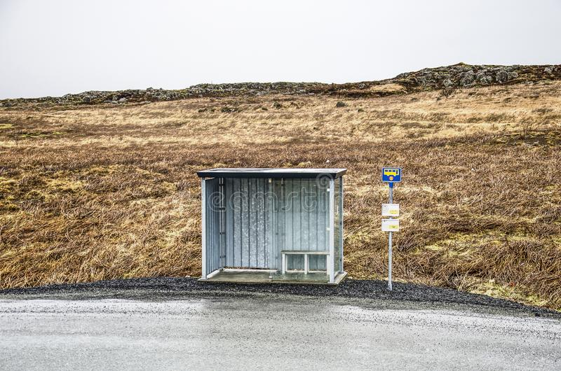 Busstop in a desolate landscape stock images
