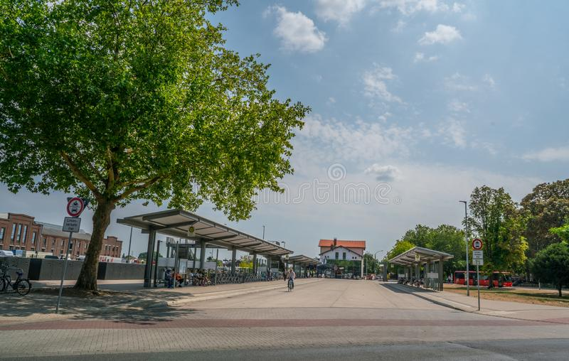 Busstop in Kleve, Germany. Kleve, Germany 21th July 2018 - People waiting for transport at the bus and train station in Kleve royalty free stock photos
