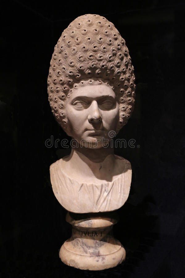 Bust of Ancient Roman Woman. Marble bust of an ancient Roman woman with beehive hairdo stock photo