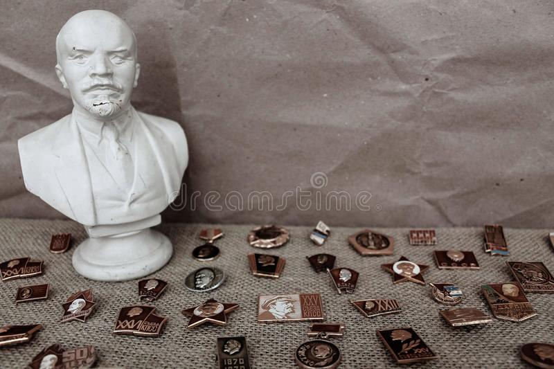 Bust of Lenin and badges with communist symbols stock photos