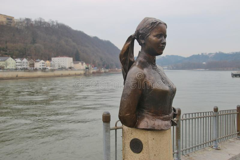 Bust of the poet and landlady Emerenz Meier on the quay of the Danube river in Passau, Germany. Passau, Bavaria, Germany - February 21, 2019: Bust of the poet stock photo