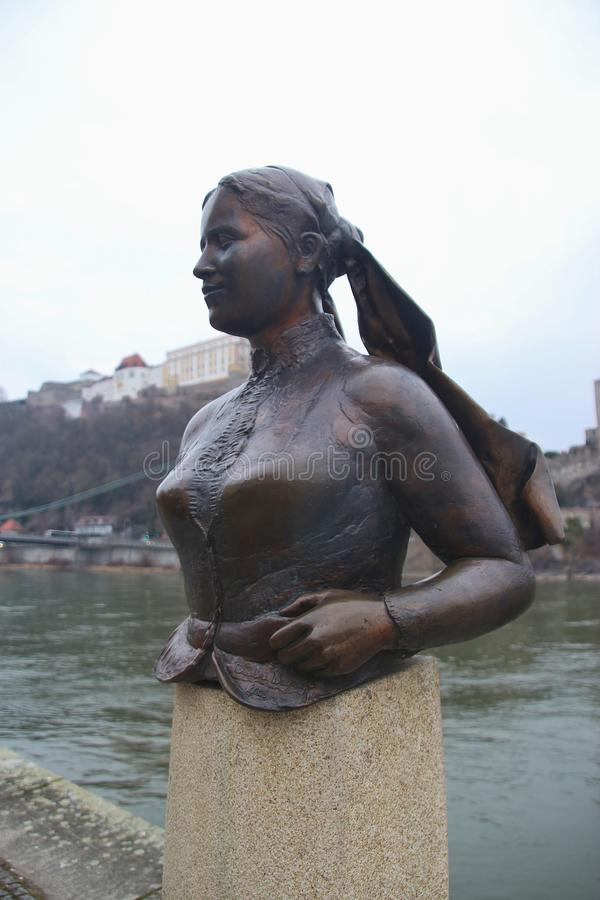 Bust of the poet and landlady Emerenz Meier on the quay of the Danube river in Passau, Germany. Passau, Bavaria, Germany - February 21, 2019: Bust of the poet royalty free stock images