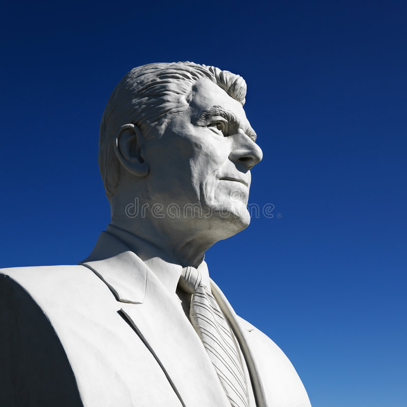 Bust of Ronald Reagan sculpture in President's Park, Black Hills. Bust of Ronald Reagan sculpture against blue sky in President's Park, Black Hills, South Dakota royalty free stock photos