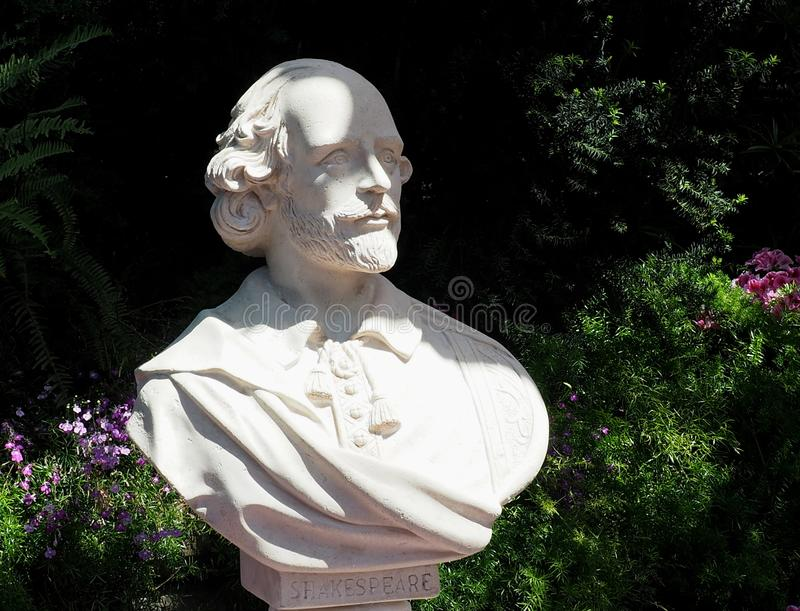 Bust Of William Shakespeare. With plants and flowers royalty free stock image