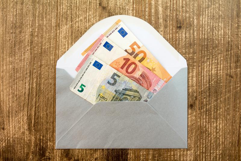 Busta d'argento con euro valuta fotografia stock