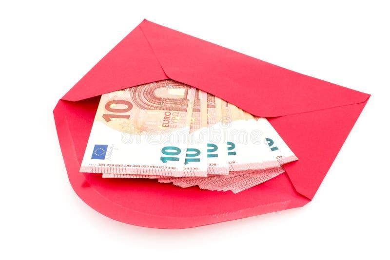 Busta rossa con soldi immagini stock