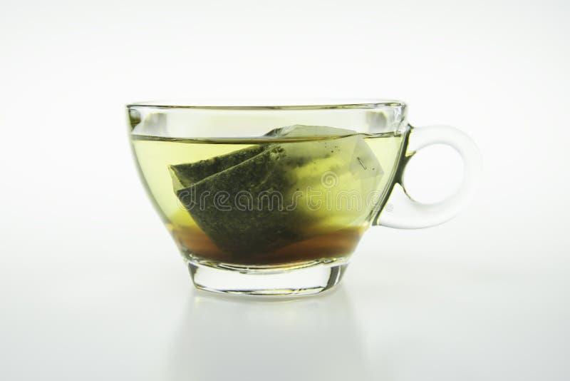 Bustina di tè messa in vetro immagini stock