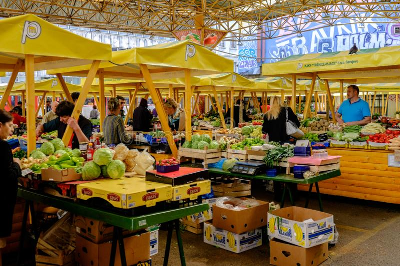 Sarajevo market, Bosnia and Herzegovina. The bustling main market in Sarajevo - site of a shocking bomb attack during the Bosnian war which left many civilians stock photo