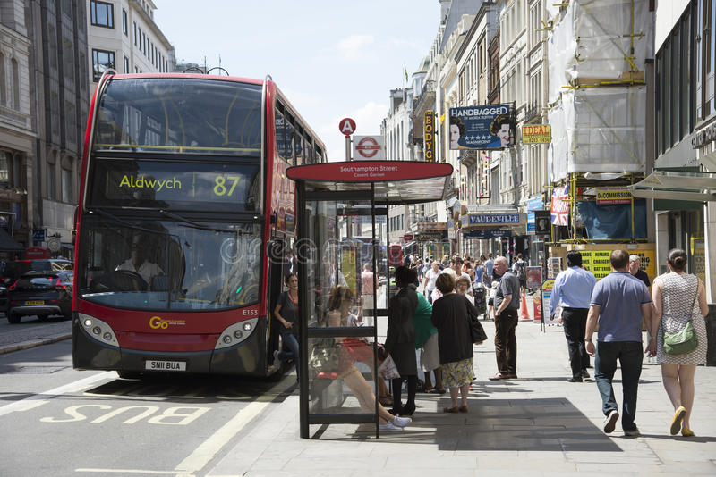 Bustop and London bus stock photo