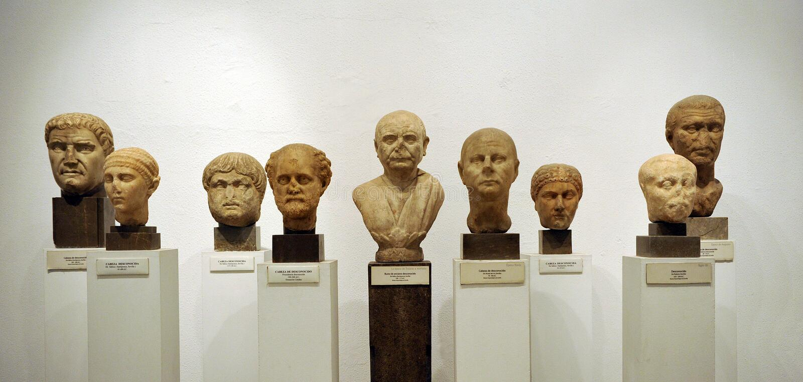 Busts of Roman citizens, marble sculptures. Heads of Roman citizens inhabitants of the city of Italica, which is in the Archaeological Museum of Seville stock photo