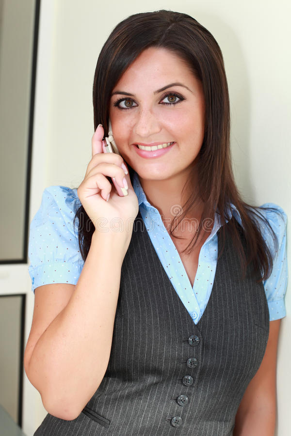 Busty Lady Talking On Mobile Cellphone Stock Photo