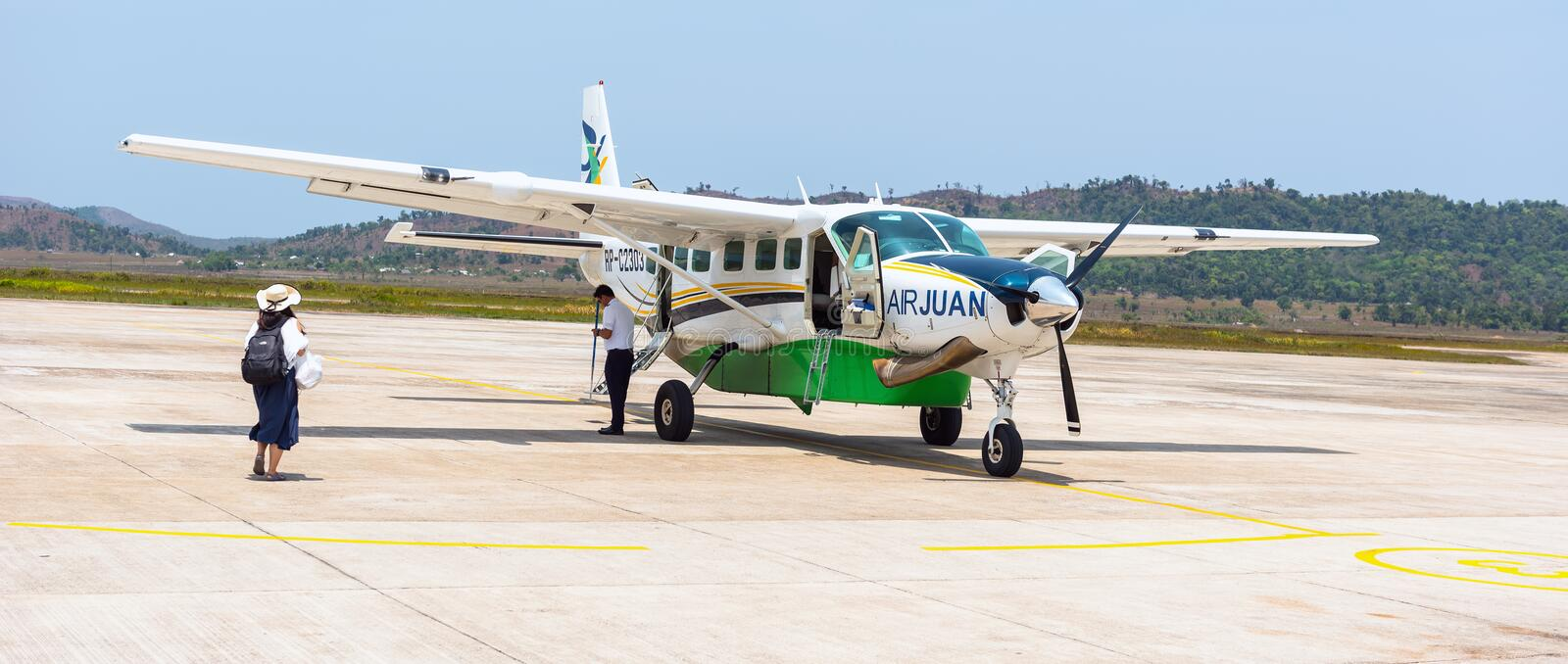 Small private 9 seat Airplane most popular transport at Palawans in Busuanga airport in Coron privince Busuanga island. stock photos