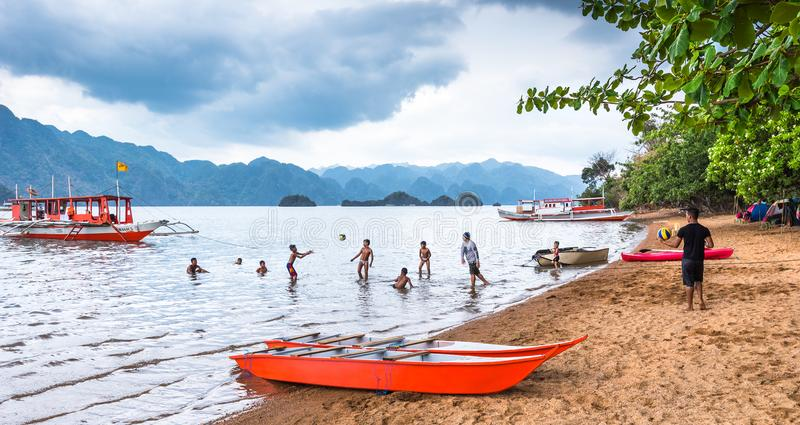 View of playing children at Busuanga against of Coron island, Palawan Philippines stock images