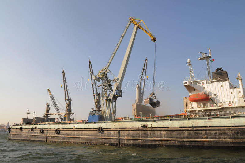 Crane Loading A Cargo Ship - World Business - Economy Royalty Free Stock Photo