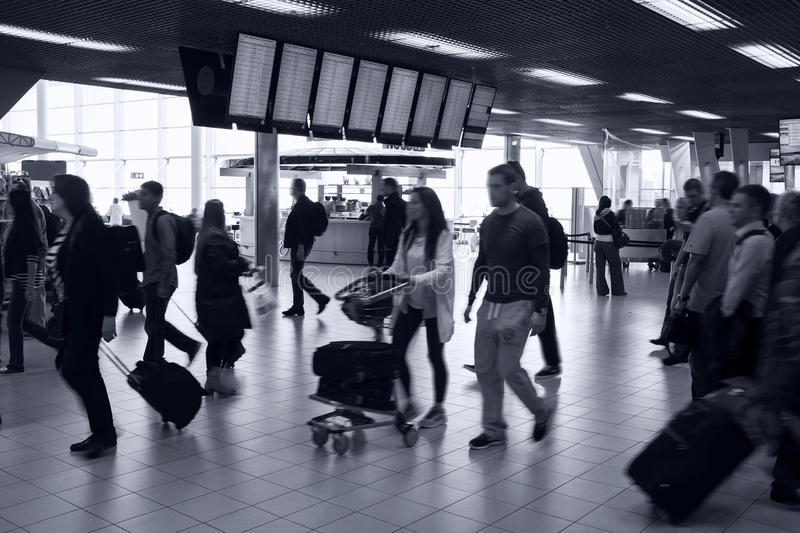 Busy airport interior. And screens with flights info royalty free stock photo