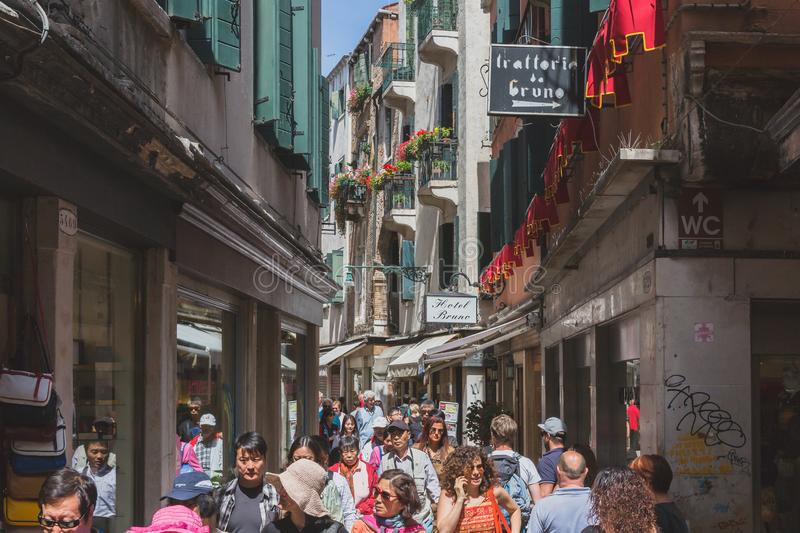 Busy alley street filled with tourists. Venice, Italy - June 6, 2017: Busy alley street filled with tourists stock images