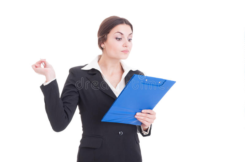 Busy and arrogant woman business inspector or supervisor. Holding clipboard with checklist isolated on white background royalty free stock photography