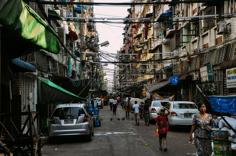 Busy back alley in Yangon. stock images